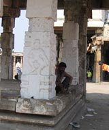 man and pillar
